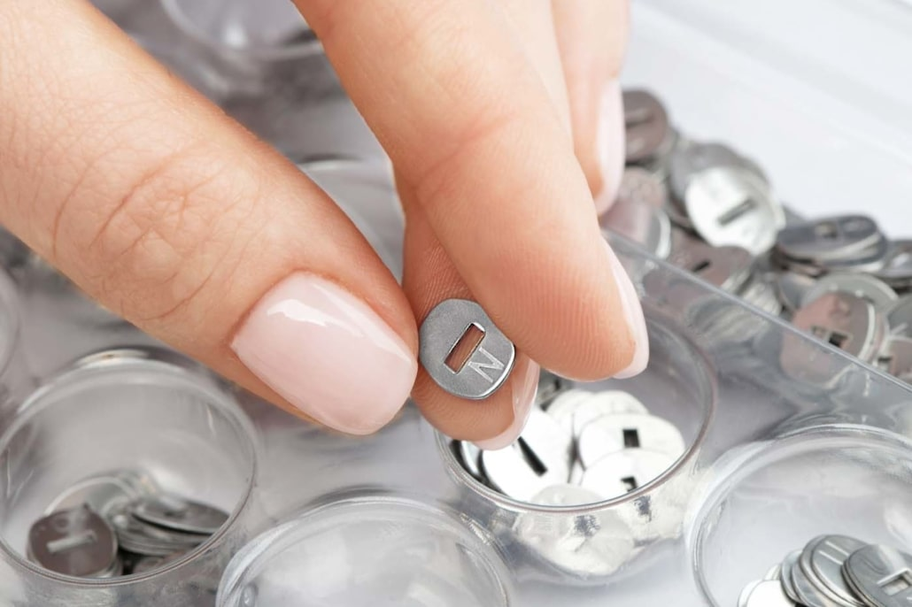 capsule-hand-with-box-and-letters-1030x686-min